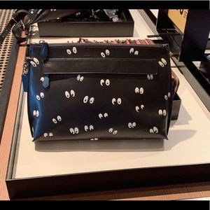 coach disney carryall pouch with spooky eyes print